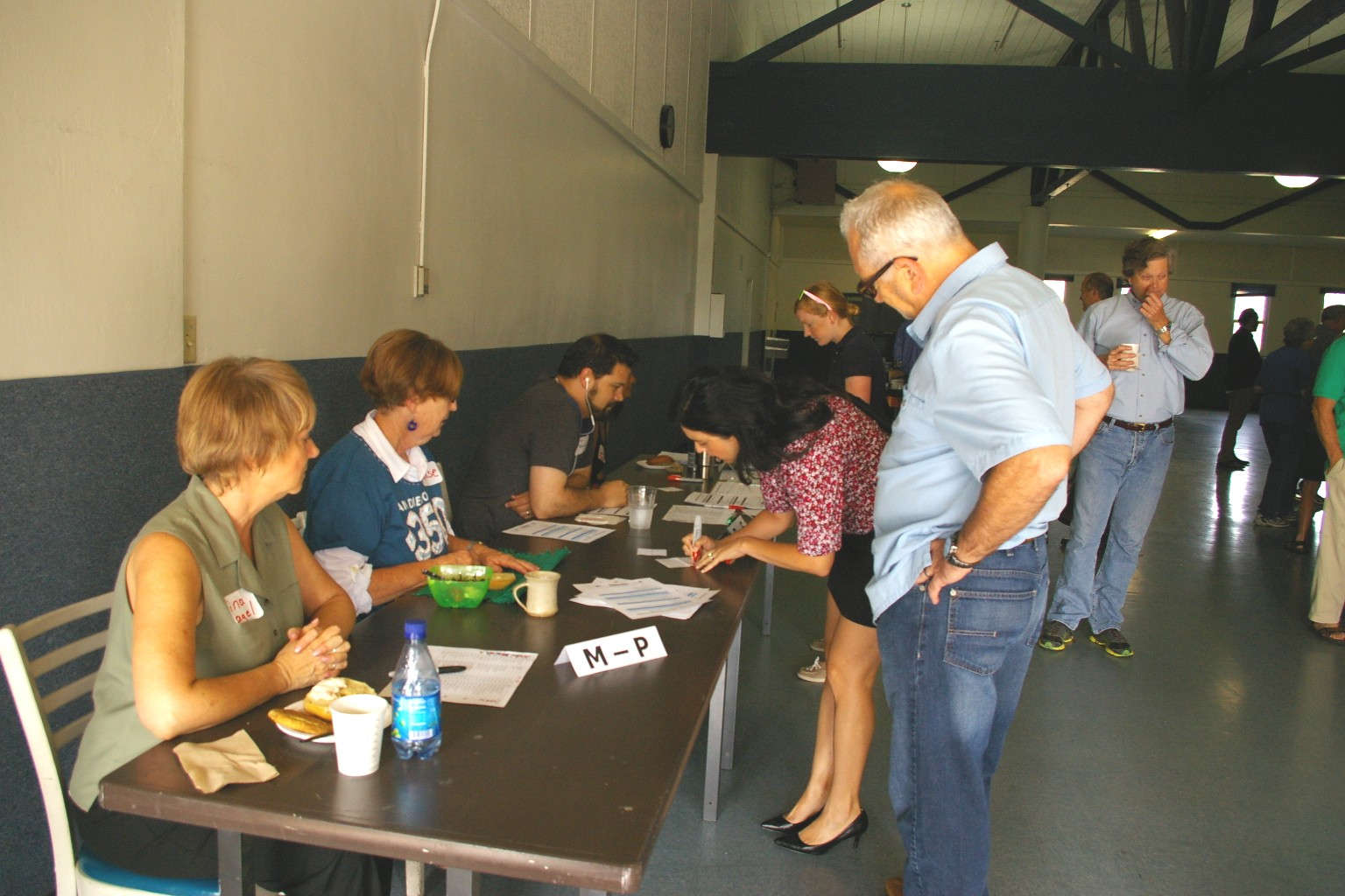 Tina Nagel, Louise Russell and Kevin Perkins signing folks in