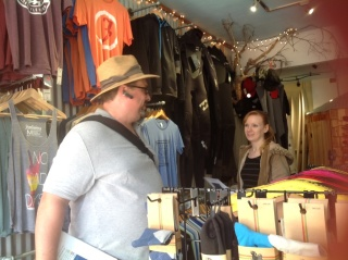 Ken Brucker talks with employee at   Surf Shop