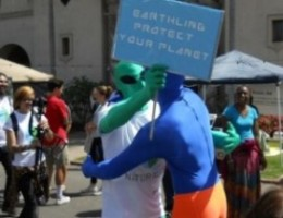 Blue Man embrace of a kindred spirit from outer space draws cameras.
