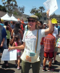 Nicole appeals to fair-goers to learn about the harm caused by fracking.