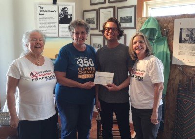SD350 Fracking Team members ? Peg MItchell, and ?accept grant check from Cardiff store manager Dalton ???
