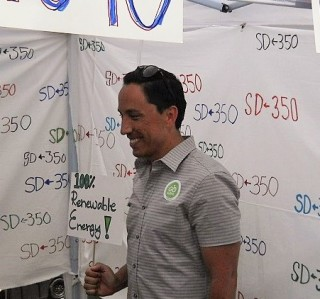 Todd Gloria holds a placard for his session in the photo booth.