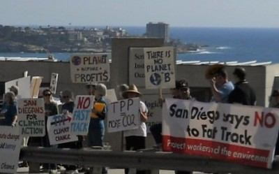 Rounding a bend on La Jolla Shores Drive, UCSD commuters met SD350 placards and banners.