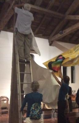 Bill Wellhouse hands down banners to Bill Avrin.