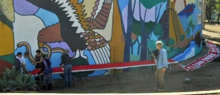 Bev surveys the banner wrapping around the Centro Cultural.