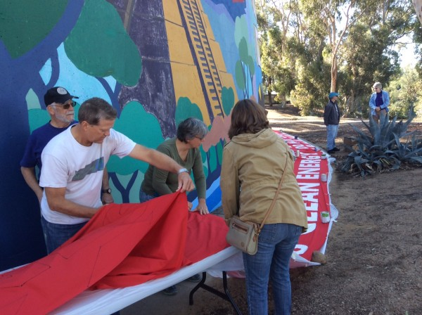 Getting ready to move the freshly painted banner to the drying area