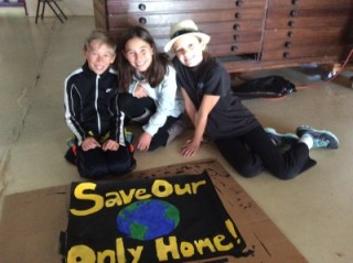 Ian, Collette and Ania with the poster they designed and painted.
