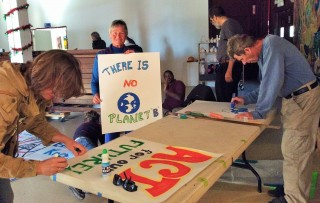 Stephanie, Rae and Neal create posters with strong messages and visual appeal.
